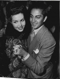 Maharaja of Cooch Behar Jagaddipendra Narayan dancing with actress Ann Miller at a party in 1947