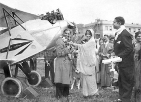 Maharani of Cooch Behar Indiraraje doing a ritual for the inauguration of a solo flight in 1929