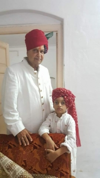 Maharana Mahipendra Sinhji with his grandson Bhawarsa Prajayrajsinhji