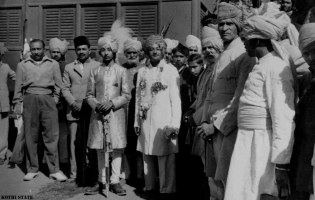 Raja Bahadur Kaushalendra Pratap Singh (centre), Raja of Kothi fl. 1935, with his son Raja Bahadur Govind Pratap Singh, at his wedding