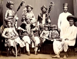 Maharana Gambhirsinhji Verisalji of Rajpipla with his eldest son Yuvraj Chhatrasinhji, two other younger sons and courtiers in 1875.