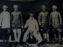 Sohangarh family, sitting on chair Th. Sohan Singh ji  with his 4 sons and grandson Balwant Singh sitting on carpet