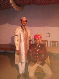 Shri Thakur Lal Sahab Maharaj Kumar Balvendra Pratap Singh Ji Thakur Sahab Thikana Tikuri with standing Bhawar Lal Mrigendra Singh Ji