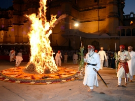 Shriji Arvind Singh Mewar and Lakshyaraj Singh Mewar circumambulating the Holika effigy